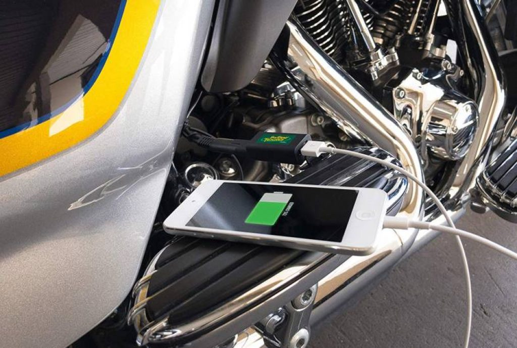demonstrating the usb charge for motorcycle