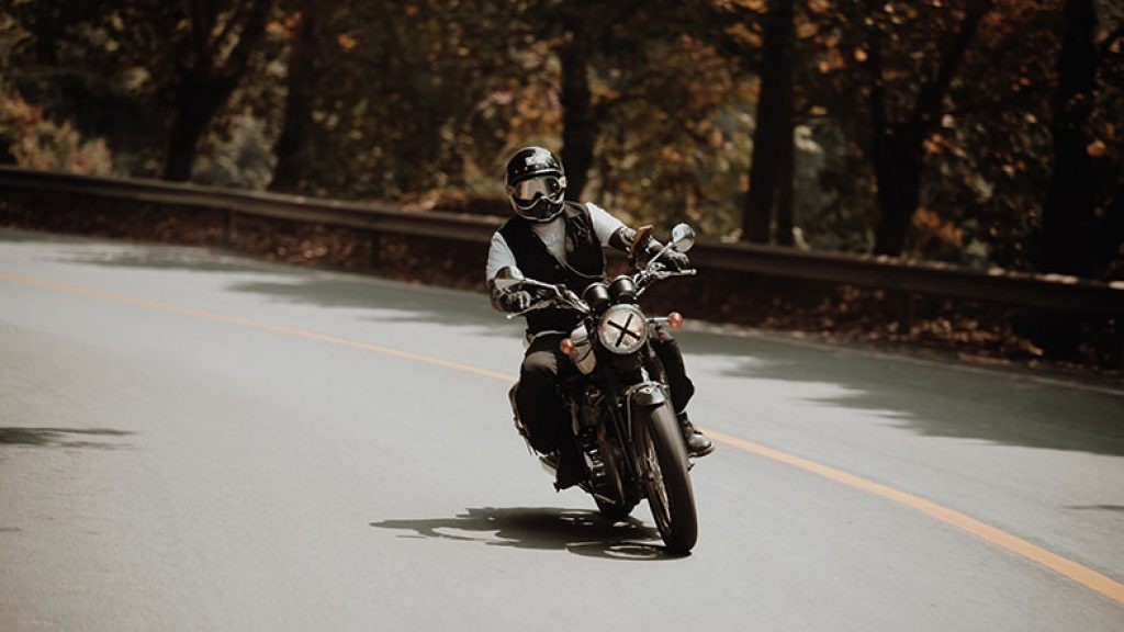 a man is riding a motorcycle