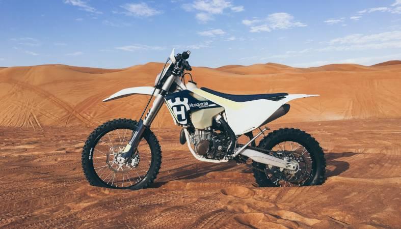 a white motorbike in the desert