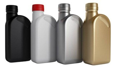 four oil containers in different colors