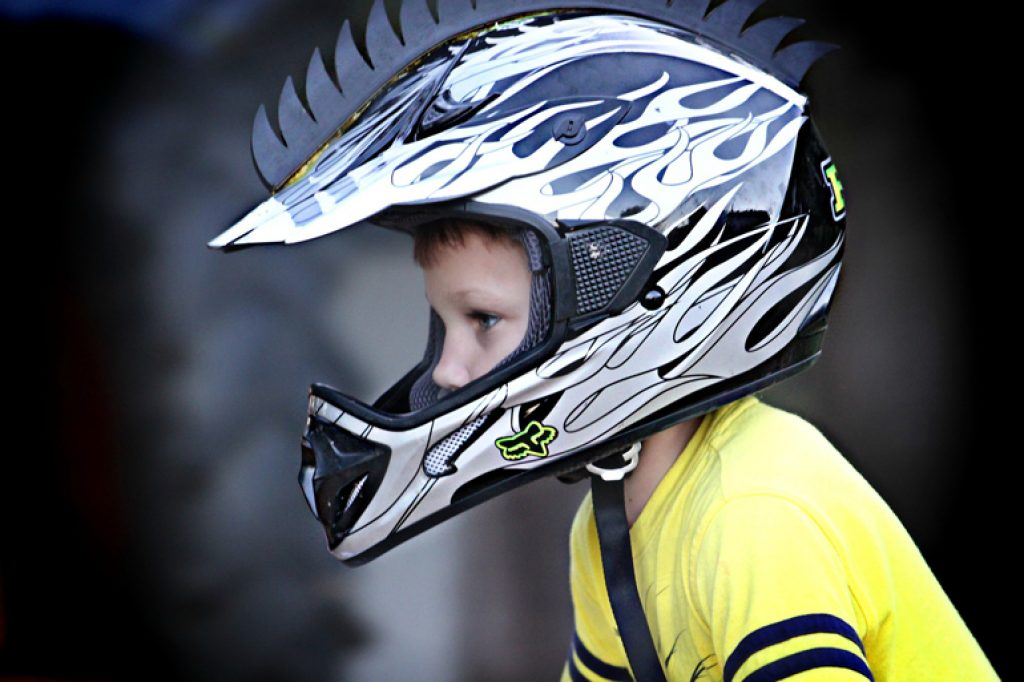 Little Boy Wearing Black and White Helmet