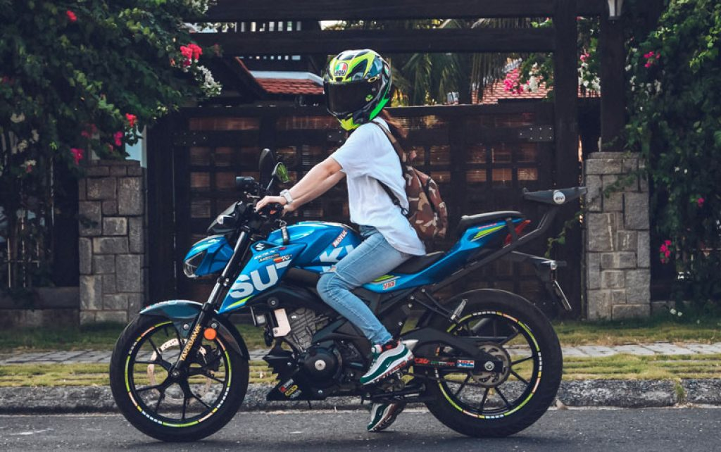 image of a girl on motorcycle