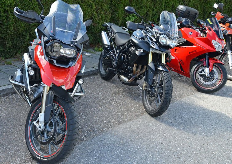 image of three parked motorcycles