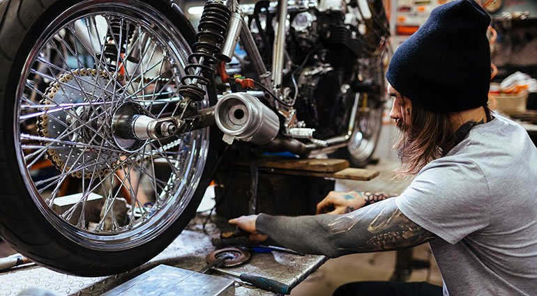 Motorcycle Specialist Fixing A Motorcycle