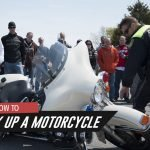 How to pick up a motorcycle image