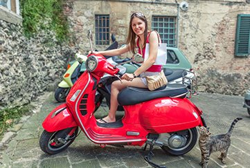 Young Woman Sitting on a Red Scooter