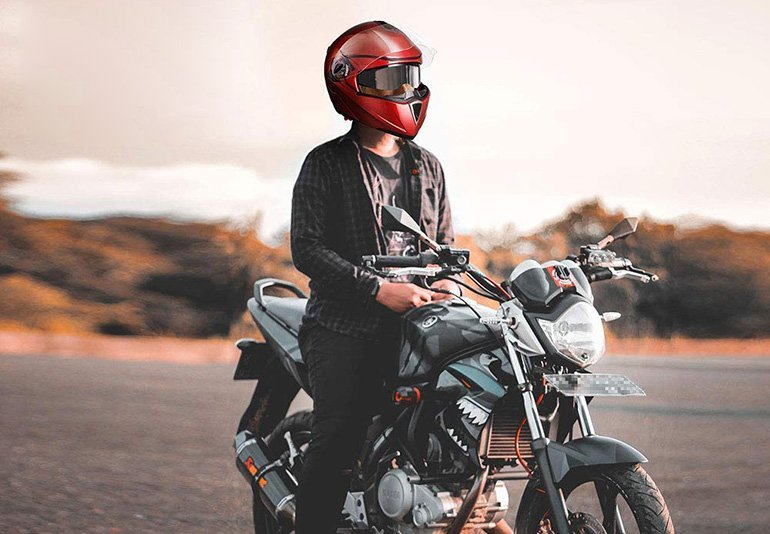 A Man On Motorcycle Wearing AHR Modular Helmet
