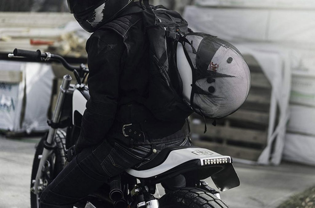 image of motorcycle rider wearing backpack
