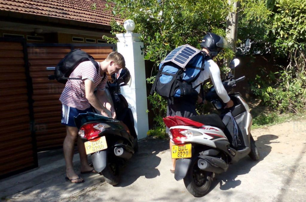 image of two guys getting ready to travel on motorcycles