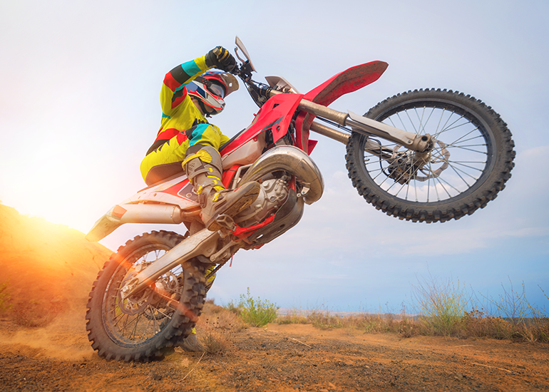 image of wheelie on a dirt bike