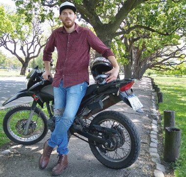 Jordan Russell Standing By His Motorbike