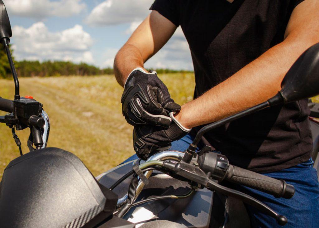 image of man putting gloves