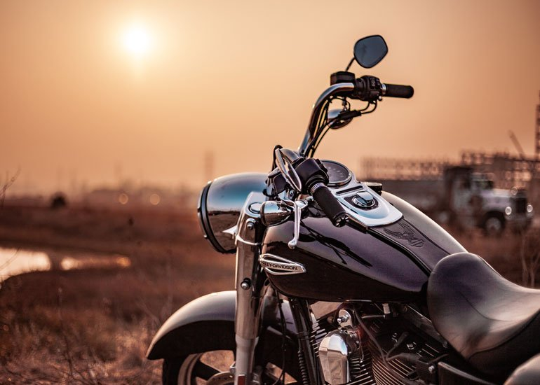 image of motorcycle parked sunset