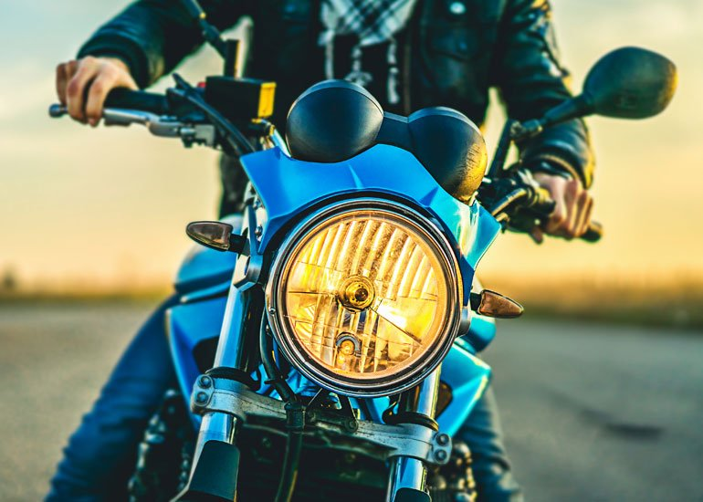 image of motorbike in the sunset