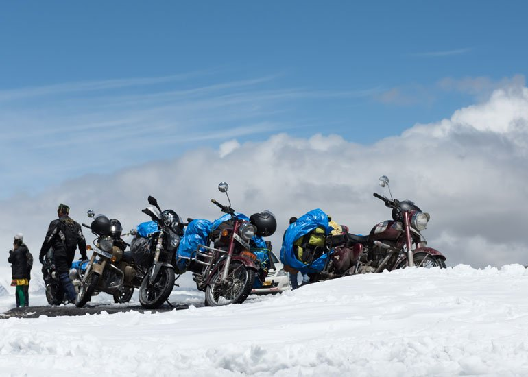 image of parked motorbikes and snow