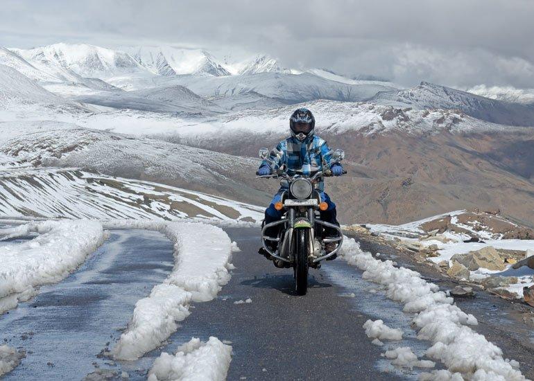 image of riding motorbike on mountain roadimage of riding motorbike on mountain road