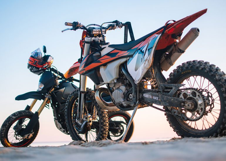 image of two black and orange motorbikes