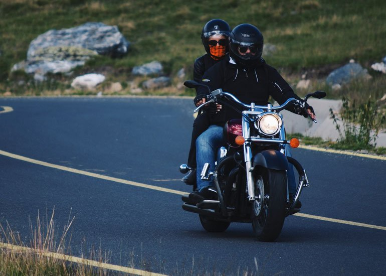 image of two persons on motorbike
