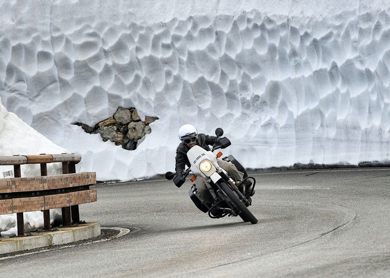 image of man rides a bike in winter weather