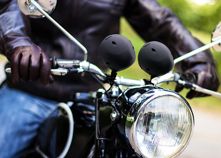 image of motorbike and two speakers